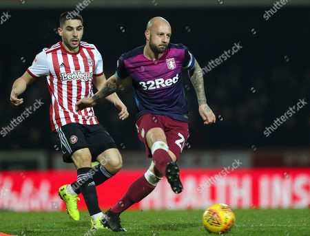 Alan Hutton of Aston Villa and Neal Maupay of Brentford