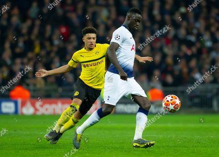 Davinson Sanchez of Tottenham Hotspurs is shadowed by Jason Sancho of Borussia Dortmund