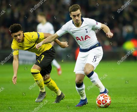 Harry Winks of Tottenham Hotspurs slips past Jason Sancho of Borussia Dortmund