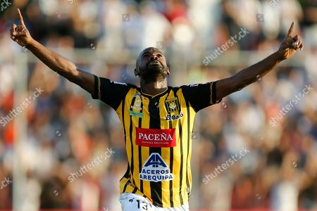 Adolfo Machado of Bolivia's The Strongest celebrates after scoring against Paraguay's Libertad during a Copa Libertadores soccer game, in Asuncion, Paraguay
