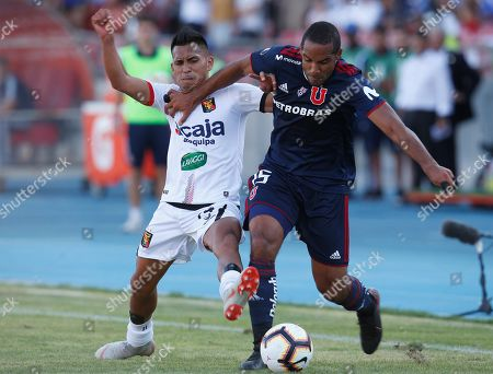 Jean Beausejour (R) of Universidad de Chile vies for the ball with Alexis Arias (L) of Melgar during a Copa Libertadores second leg match between Universidad de Chile and Melgar, at the National Stadium of Chile, in Santiago, Chile, 13 February 2019.