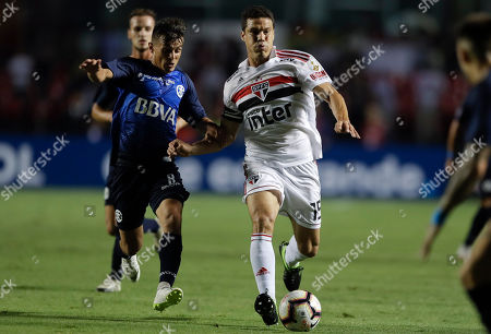 Hernanes of Brazil's Sao Paulo, right, is challenged by Andres Cubas of Argentina's Talleres during a Copa Libertadores soccer match in Sao Paulo, Brazil, . Talleres won 2-0 on aggregate and advanced to the next round
