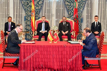 In this photo provided by the Royal Palace via the Moroccan News Agency (MAP), Moroccan King Mohammed VI and King Don Felipe VI of Spain preside over the signing of bilateral agreements between the two countries at the king palace in Rabat, Morocco . Morocco's Crown Prince Moulay Hassan, right, and Prince Moulay Rachid, left, look on