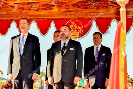In this photo provided by the Moroccan Royal Palace via the Moroccan News Agency (MAP), from left, King Don Felipe VI of Spain, Morocco's Crown Prince Moulay Hassan, Moroccan King Mohammed VI and Prince Moulay Rachid listen to the national anthem during an official welcoming ceremony at the Royal Palace in Rabat, Morocco . King Don Felipe VI is on two days official visit to Morocco at the invitation of King Mohammed VI