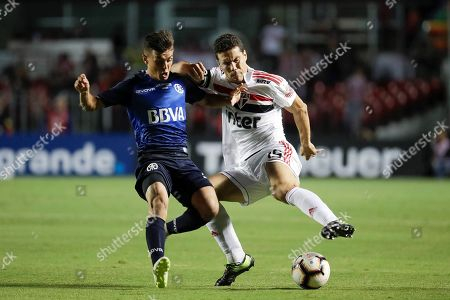 Talleres' Andres Cubas (L) vies for the ball with Hernanes (R) of Sao Paulo during a match for the Copa Libertadores between Brazil's Sao Paulo and Argentina's Talleres held at the Morumbi Stadiu, in Sao Paulo, Brazil, 13 February 2019.