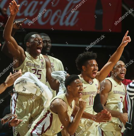 Florida State forward Mfiondu Kabengele (25) and guards David Nichols (11) and Trent Forrest (3) react on the bench near the end of the second half against Wake Forest in an NCAA college basketball game in Tallahassee, Fla., . Florida State won 88-66