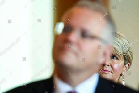 Former Australian Foreign Minister Julie Bishop is seen behind Australian Prime Minister Scott Morrison as they attend the International Women's Day breakfast at Parliament House in Canberra, Australia, 14 February 2019. International Women's Day is held annually on the 08 March.