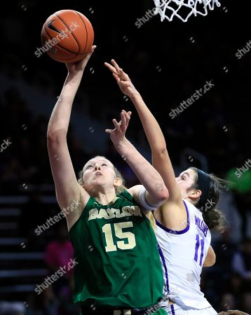 Lauren Cox, Peyton Williams. Baylor forward Lauren Cox (15) shoots while covered by Kansas State forward Peyton Williams (11) during the first half of an NCAA college basketball game in Manhattan, Kan