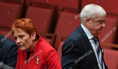 One Nation leader Senator Pauline Hanson (L) and former One Nation Senator Brian Burston after the Income Tax vote in the Senate Chamber at Parliament House in Canberra, Australian Capital Territory, Australia, 14 February 2019. UAP Senator Burston was allegedly involved in a physical altercation with James Ashby, his former party leader's adviser, in Parliament House on the 13 February, media reported.