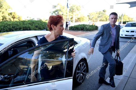 One Nation leader Senator Pauline Hanson (L) and media advisor James Ashby arrive at Parliament House in Canberra, Australian Capital Territory, Australia, 14 February 2019. United Australia Party (UAP) Senator Brian Burston was allegedly involved in a physical altercation with James Ashby, his former party leader's adviser, in Parliament House on the 13 February, media reported.