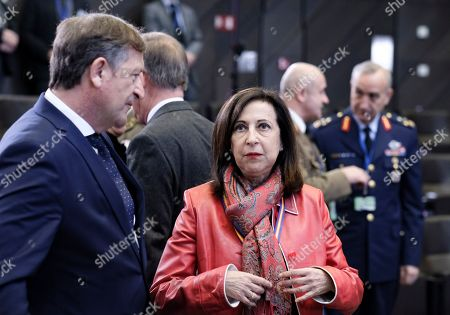 Stock Image of Spanish Defense Minister, Margarita Robles and Slovenia Defense minister Karl Erjavec (L) during NATO defense ministers meeting at NATO headquarters in Brussels, Belgium, 14 February 2019. Members of the defense alliance were to discuss current security issues, including Russia's violation of the INF (Intermediate-Range Nuclear Forces ) Treaty, as well as to review its missions in Afghanistan, Kosovo, Iraq and other areas, NATO said.