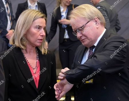 European Union foreign policy chief Federica Mogherini and Sweden's Defence Minister Peter Hultqvist (R) during NATO defense ministers meeting at NATO headquarters in Brussels, Belgium, 14 February 2019. Members of the defense alliance were to discuss current security issues, including Russia's violation of the INF (Intermediate-Range Nuclear Forces ) Treaty, as well as to review its missions in Afghanistan, Kosovo, Iraq and other areas, NATO said.