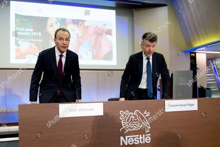 Nestle's CEO Ulf Mark Schneider (L) speaks next to Nestle's CFO Francois-Xavier Roger, right, during the 2018 full-year results press conference of the food and drinks company Nestle, in Vevey, Switzerland, 14 February 2019.