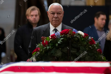 General Colin Powell pays his respects as he views the casket of President George H.W. Bush in the United States Capitol Rotunda on Capitol Hill in Washington, DC