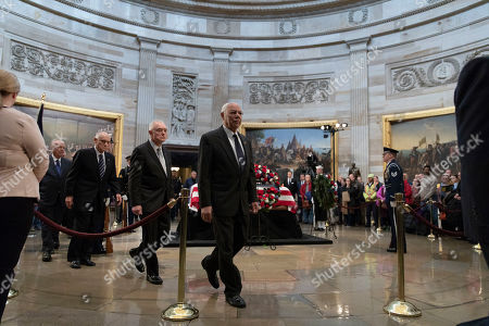 General Colin Powell departs after paying his respects as he views the casket of President George H.W. Bush in the United States Capitol Rotunda on Capitol Hill in Washington, DC