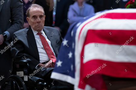 Former Senator Bob Dole, Republican of Kansas, pays his respects while viewing the casket of President George H.W. Bush in the United States Capitol Rotunda on Capitol Hill in Washington, DC