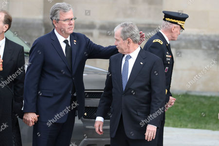 Former US President George W Bush, right, and his brother, former Florida Governor, Jeb Bush, arrive for the funeral of late US President George H.W. Bush at the National Cathedral in Washington, DC