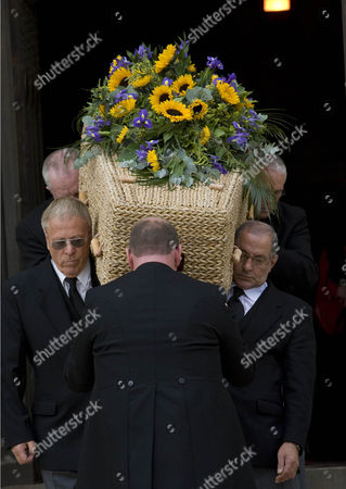 Keith Floyd's banana leaf coffin as it leaves the service