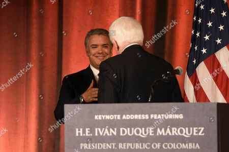 Colombian President Ivan Duque Marquez is greeted by U.S. Chamber of Commerce President and CEO Thomas Donohue at the U.S. Chamber of Commerce in Washington, on