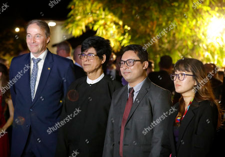 EU Ambassador to Myanmar Kristian Schmidt (L), Human Rights defender Robert Sann Aung (2-L), peace advocate Aung Kyaw Moe (2-R) and Nan Bawk (R) (sister in law of Nang Pu) attend the 2019 Schuman Awards ceremony at the EU Ambassador residence in Yangon, Myanmar, 14 February 2019. The European Union in Myanmar gives the annual Schuman Awards to recognize outstanding merits in the promotion of universal values of democracy, rule of law, peace and human rights. Gender and peace activist Nang Pu from Kachin State, who currently in prison, peace advocate Aung Kyaw Moe and human rights defender Robert Sann Aung receive the 2019 Schuman Awards.