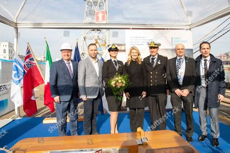 From left, Keith Taylor, Tony Roberts, Kerry Ann Wright, Jan Swartz, Captain Michele Tuvo, Firouz Mal and Cyril Tatar are on hand as Princess Cruises showcases progress of three new Royal-class ships, at the Fincantieri shipyard in Maonfalcone, Italy. In a cruise industry first, Princess Cruises today marks three major construction milestones for one cruise line in one day. These milestones include the honoring of the Sky Princess Madrina, keel laying for Enchanted Princess and steel cutting ceremony for the sixth Royal Class ship ? all being built by long-time partner Fincantieri