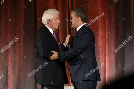 Stock Image of U.S. Chamber of Commerce President and CEO Thomas Donohue, left, interacts with Colombian President Ivan Duque Marquez at the U.S. Chamber of Commerce in Washington, on