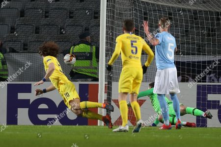 David Luiz of Chelsea heads a shot from Arnor Ingvi Traustason of Malmo FF past the post