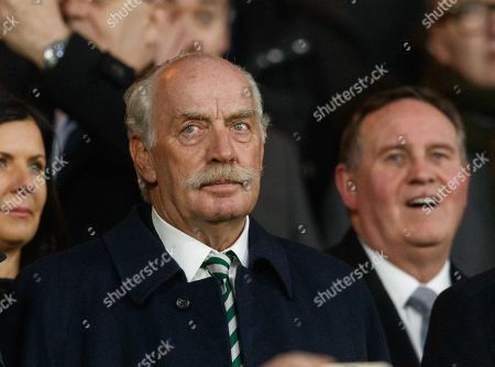 Celtic major shareholder Dermot Desmond watches the lightship before kick off from the Director's Box.