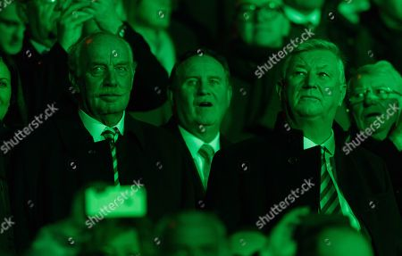 Celtic major shareholder Dermot Desmond watches the lightshow before kick off from the Director's Box, with Celtic Chief Executive Peter Lawwell, right.