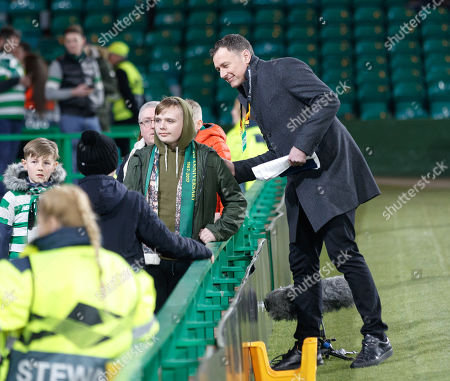 Chris Sutton, former Celtic striker turned TV pundit poses for a photograph with a fan.