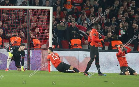 Jailson,Robert Makv. From left to right, Rennes' goalkeeper Thomas Koubek, Rennes' Rame Bensebaini, Rennes' M'Baye Niang and Rennes' Benjamin Andre react after Betis' Diego Lainez scores his side's equalizer during the UEFA Europa League round of 32 soccer match between Rennes and Real Betis at Roazhon Park stadium in Rennes, western France