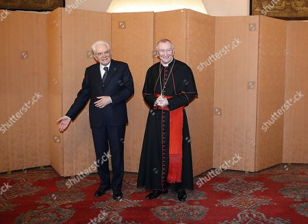Vatican Secretary of State Cardinal Pietro Parolin with President of the Italian Republic, Sergio Mattarella, during the ceremony for the 90th anniversary of the Lateran Pacts and the thirty-fifth anniversary of the Amendment Agreement, in Rome, Italy, 14 February 2019. The Lateran Pact of 1929, or Lateran Treaty, between Italy and the Vatican was signed by Benito Mussolini for the Italian government and by cardinal secretary of state Pietro Gasparri for the papacy. The papacy recognized the state of Italy, with Rome as its capital, Italy in return recognized papal sovereignty over the Vatican City and secured full independence for the pope.