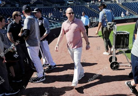 New York Yankees general manager Brian Cashman walks on the field at the Yankees spring training baseball facility, in Tampa, Fla