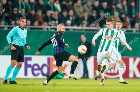 Inter Milan''s Borja Valero (L) in action against Rapid's Srdjan Grahovac (R) during the UEFA Europa League round of 32 first leg soccer match between SK Rapid Vienna and Inter Milan in Vienna, Austria, 14 February 2019.