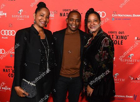"""Nat King Cole's daughters, Timolin Cole and Casey Cole, flank Dulé Hill at the opening night party for the West Coast premiere of Lights Out: Nat """"King"""" Cole at Geffen Playhouse, in Los Angeles. Dulé portrays Mr. Cole in the production"""