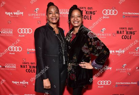 """Nat King Cole's daughters Timolin Cole, left, and Casey Cole pose at the opening night party for the West Coast premiere of Lights Out: Nat """"King"""" Cole at Geffen Playhouse, in Los Angeles"""