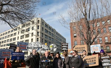 Stock Photo of New York City Councilman Jimmy Van Bramer, center, speaks during a press conference in Gordon Triangle Park in the Queens borough of New York, following Amazon's announcement it would abandon its proposed headquarters for the area