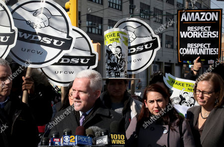 New York City Councilman Jimmy Van Bramer, second from left, speaks during a press conference in Gordon Triangle Park in the Queens borough of New York, following Amazon's announcement it would abandon its proposed headquarters for the area