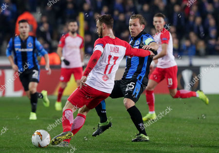 Andreas Ulmer of FC Salzburg (L) and Ruud Vormer of Club Brugge KV  in action during an UEFA Europa League soccer match, round 32, between Club Brugge KV and FC Salzburg at the Jan Breydel Stadium in Bruges, Belgium, 14 February 2019.