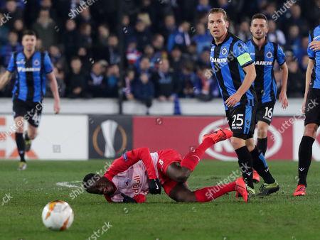Diadie Samassekou of FC Salzburg (L) and Ruud Vormer of Club Brugge KV  in action during an UEFA Europa League soccer match, round 32, between Club Brugge KV and FC Salzburg at the Jan Breydel Stadium in Bruges, Belgium, 14 February 2019.