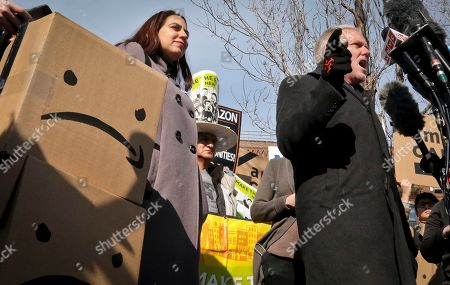 New York City Councilman Jimmy Van Bramer, right, speaks during a press conference in Gordon Triangle Park in the Queens borough of New York following Amazon's announcement it would abandon its proposed headquarters for the area