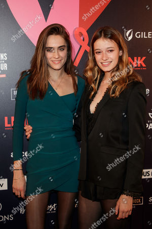 Stock Picture of Models Charlotte Coquelin (L) and Jade de Lavareille (R) arrive at the 'Bal ParAmour' or Paramour ball, a charity event to celebrate love and support the fight against AIDS, at the City Hall of Paris, France, 14 February 2019, on Valentine?s Day. Organised by LINK endowment fund, this dance party is inspired by Vienna's Life Ball, one of the most important charity events in Europe.