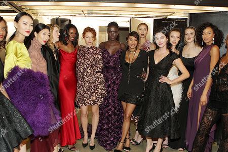 Designer Aisha Mcshaw with her models backstage