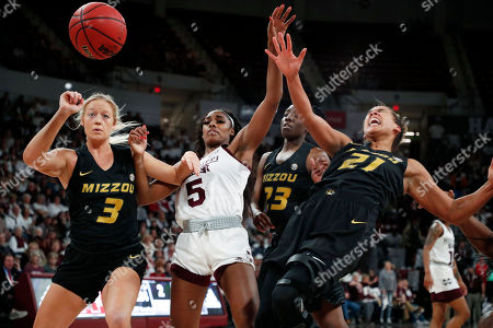 Anriel Howard, Cierra Porter, Sophie Cunningham, Amber Smith. Mississippi State forward Anriel Howard (5) and Missouri guard Sophie Cunningham (3), forward Cierra Porter (21) and guard Amber Smith (23) watch the ball get away during the first half of an NCAA college basketball game, in Starkville, Miss