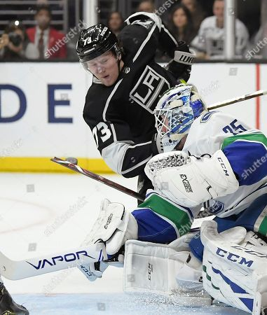 Los Angeles Kings right wing Tyler Toffoli, top, breaks his stick as he tries to score on Vancouver Canucks goaltender Jacob Markstrom during the second period of an NHL hockey game, in Los Angeles