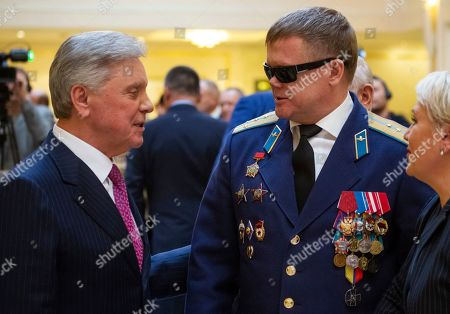 Vladimir Vshivtsev, Boris Gromov. On, Vladimir Vshivtsev, a veteran of the Soviet war in Afghanistan, right, and Gen. Col. Boris Gromov, former Commander of the 40th Army in Afghanistan, greet each other during a meeting at the upper chamber of Russian parliament in Moscow, Russia. Vshivtsev, who was wounded in action and lost his eye-sight, became a leading activist in the Russian Society for the Blind and served a stint in the Russian parliament