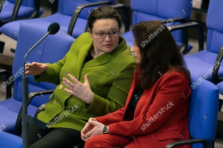 Andrea Nahles (L), parliamentary group leader of the Social Democratic Party (SPD) and SPD party member Yasmin Fahimi (R) talk during the German parliament Bundestag in Berlin, Germany, 15 February 2019. The German parliament Bundestag gathered for its 81 session of the 19th legislative period.