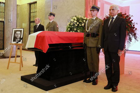 Stock Photo of Former Deputy Minister of Economy Piotr Naimski (R) and former Minister of Internal Affairs and Minister of National Defence Antoni Macierewicz (L) stand at the coffin during the memorial services for former Polish Prime Minister Jan Olszewski in the main hall of the Prime Minister's Office in Warsaw, Poland, 15 February 2019. On 16 February, following memorial service at Warsaw Cathedral, the former PM will be laid to rest at Warsaw's Pow¹zki Military Cemetery. Jan Olszewski , who died at the age of 88 on 07 February, headed the Polish government in 1991-1992.