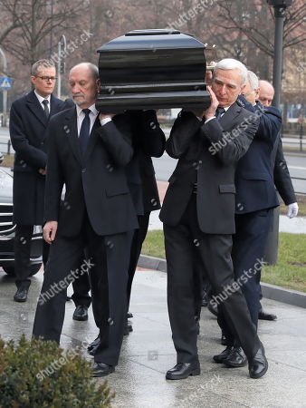 Stock Image of Former Deputy Minister of Economy Piotr Naimski (R) and former Minister of Internal Affairs and Minister of National Defence Antoni Macierewicz (L) carry a coffin during the memorial services for former Polish Prime Minister Jan Olszewski in the main hall of the Prime Minister's Office in Warsaw, Poland, 15 February 2019. On 16 February, following memorial service at Warsaw Cathedral, the former PM will be laid to rest at Warsaw's Pow¹zki Military Cemetery. Jan Olszewski , who died at the age of 88 on 07 February, headed the Polish government in 1991-1992.