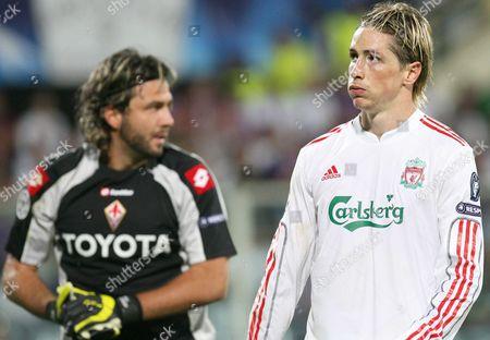 Fernando Torres of Liverpool after missing a goal in background Fiorentina's French goalkeeper Sebastien Frey